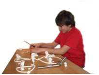 Child modeling clay at table